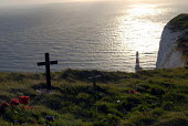 A cross for one of the victims of suicide and the lighthouse at Beachy Head, Sussex, UK 2008 - Howard Davies - 25-01-2008