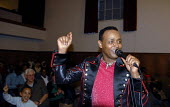 Kemer Yousef a well known Oromo singer and activist who lives as a refugee in Canada performs at an Oromo community event during a tour of the UK. Brighton, UK 2008 - Howard Davies - 25-01-2008
