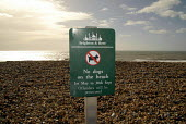 Signs on Brighton seafront warning dog owners to keep their dogs off the beaches for part of the year. Brighton. UK 2008 - Howard Davies - 01-03-2008