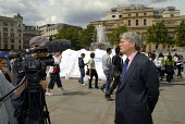Andrew Mitchell MP visiting UNHCR tents and destroyed Darfur village set up in London Trafalgar Square to commemorate World Refugee Day 2008 - Howard Davies - 17-06-2008