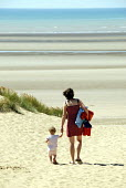 Mother and child walking to the beach with the tide out at Camber Sands, UK 2008 - Howard Davies - 23-07-2008