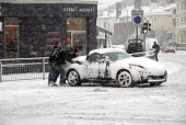 Car being pushed after skidding on snow covered roads, Brighton UK 2009 - Howard Davies - 02-02-2009