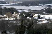 Village and church in snow, Sussex, UK - Howard Davies - &,2000s,2009,belief,cemeteries,CEMETERY,christian,christianity,church,churches,churchyard,churchyards,CLIMATE,communities,community,conditions,conviction,country,countryside,EBF,EBF Economy,Economic,E