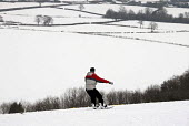 A snowboarder on Clayton Hill after heavy snow in Sussex, UK - Howard Davies - 03-02-2009