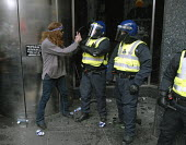 Two fingers up. Riot police confront protesters outside the Royal Bank of Scotland on the Financial Fools Day demonstrations against the G20, London, UK 2009 - Howard Davies - demonstration,demonstrations,protest,protests,bank,banks,banking,police,policing,Riot Police,Royal Bank of Scotland,RBS,RBS,bankers,city,of,london,protest,demonstration,gesture,gesturing,anti,capitali
