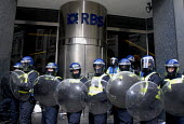 Riot police protect RBS after attacks by protesters on the Financial Fools Day demonstration against the G20, London, UK 2009 - Howard Davies - 2000s,2009,activist,ACTIVISTS,adult,adults,against,anti capitalism,anti capitalist,bank,banker,bankers,banking,banks,campaigner,campaigners,CAMPAIGNING,CAMPAIGNS,cities,city,CLJ,DEMONSTRATING,demonstr