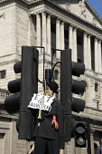 Protesters outside the Bank of England on the Financial Fools Day protest, London, UK 2009 - Howard Davies - 01-04-2009