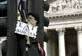 Protesters outside the Bank of England on the Financial Fools Day demonstrations, London, UK 2009 - Howard Davies - 2000s,2009,activist,ACTIVISTS,anti capitalism,anti capitalist,bank,bank of England,banker,bankers,banking,banks,campaigner,campaigners,CAMPAIGNING,CAMPAIGNS,cities,city,DEMONSTRATING,demonstration,dem