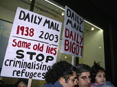Protest on Holocaust Day against the overwhelmingly negative coverage of asylum issues and refugees by the Daily Mail by recalling the pro Nazi and anti Jewish headlines of the newspaper in the 1930s.... - Howard Davies - 2000s,2003,activist,activists,against,Asylum Seekers,Asylum Seekers,Asylum Seekers protest,BAME,BAMEs,Black,BME,bmes,britain,CAMPAIGNING,CAMPAIGNS,DEMONSTRATION,demonstrations,Diaspora,displaced,diver
