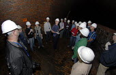 Visitors explore Brighton's Victorian sewer system on a tour, Brighton, UK. - Howard Davies - 02-05-2009