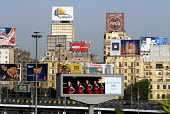 View of advertising hoardings, including Coca cola, on buildings in central Cairo, Egypt 2008 - Howard Davies - 18-04-2008