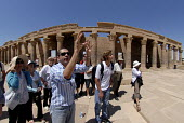 An Egyptian tour guide with tourists by the Colonnade at the Temple of Isis complex on the Island of Philae near Aswan, Egypt 2008 - Howard Davies - 09-04-2008