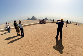 Tourists photographing the Pyramids at Giza, Cairo, Egypt 2008 - Howard Davies - 19-04-2008