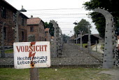 Warning signs for the electric fences surrounding Auschwitz concentration camp, Poland - Howard Davies - 11-06-2008