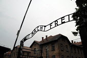 Entrance with German for Work brings Freedom or work shall set you free or will free you above the gates at Auschwitz concentration camp, Poland - Howard Davies - 11-06-2008