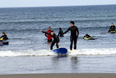 Young Irish people learning to surf with a surf training school, Co Sligo, Ireland 2008 - Howard Davies - 23-05-2008