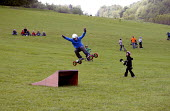 All terrain mountain boarding in Sussex, UK 2009 - Howard Davies - 2000s,2009,adolescence,adolescent,adolescents,all,boarding,boy,boys,child,CHILDHOOD,children,country,countryside,dirtboarding,enthusiast,enthusiasts,Extreme Sports,grass,hobbies,hobby,hobbyist,jump,ju