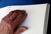 Man reading Braille book used by blind and partially sighted people, UK 2008 - Howard Davies - 27-11-2008