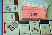 Game of Monopoly with Braille overlay used by blind and partially sighted people, UK 2008 - Howard Davies - 27-11-2008