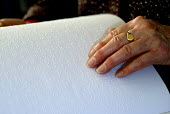 Woman reading Braille book used by blind and partially sighted people, UK 2008 - Howard Davies - 27-11-2008