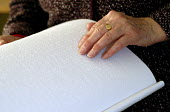 Woman reading Braille book used by blind and partially sighted people, UK 2008 - Howard Davies - 2000s,2008,alphabet,binary,blind,blindness,book,books,Braille,characters,disabilities,disability,disable,disabled,disablement,dots,encoding,FEMALE,impairment,incapacity,minorities,needs,page,pages,par