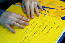 Pupil's school coursework marked with Braille, UK 2008 - Howard Davies - 2000s,2008,alphabet,binary,blind,blindness,book,books,boy,boys,Braille,characters,child,CHILDHOOD,children,communicating,communication,disabilities,disability,disable,disabled,disablement,dots,edu,edu