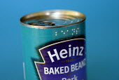 Can of Heinz baked beans with Braille dymo label made by Braille labeller used by blind and partially sighted people, UK 2008 - Howard Davies - 2000s,2008,beans,blind,blindness,Braille,can,cans,disabilities,disability,disable,disabled,disablement,food,FOODS,Heinz,impairment,incapacity,label,labelling,labels,learning,minorities,needs,partially