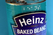 Can of Heinz baked beans with Braille dymo label made by Braille labeller used by blind and partially sighted people, UK 2008 - Howard Davies - ,2000s,2008,beans,blind,blindness,Braille,can,cans,disabilities,disability,disable,disabled,disablement,food,FOODS,Heinz,impairment,incapacity,label,labeling,labels,learning,minorities,needs,partially