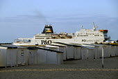 Cross channel ferry passing beach huts as it leaves Calais port, France 2009 - Howard Davies - 14-07-2009