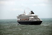 Cruise ship accompanied by a small barge as it departs from Dover Port in rough seas, UK 2009 - Howard Davies - 17-07-2009