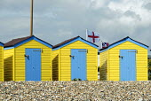 Colourful beach huts with Union Flag and St Georges Cross flying on Littlehampton sea front, UK 2009 - Howard Davies - 02-08-2009