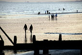 Holidaymakers walking at low tide on East Wittering beach, Sussex, UK 2009 - Howard Davies - 08-08-2009