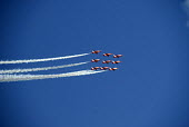 RAF Red Arrows display team performing in their diamond nine formation in the sky over Weymouth, Dorset. - Howard Davies - 19-08-2009