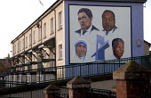 The politician John Hume, and the famous civil rights leaders Martin Luther King, Mother Theresa and Nelson Mandela in a mural in the Peoples Gallery by the Bogside Artists, Derry. - Howard Davies - 2000s,2009,ACE,ace art culture arts,adult,adults,architecture,art,arts,artwork,artworks,Bogside,building,buildings,cities,city,civil rights,conflict,conflicts,culture,Derry,exhibition,FAMILY,FEMALE,fi