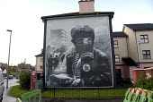 A petrol bomber with a gas mask and a molotov cocktail during the Battle of the Bogside, a Republican mural in the Peoples Gallery by the Bogside Artists, Derry. - Howard Davies - 20-11-2009