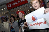 Protest against alleged serious tax evasion by Vodafone by activists outside a Vodafone shop , Brighton, UK 2010 - Howard Davies - 30-10-2010