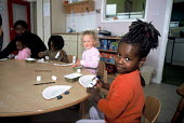 Children whose family are seeking asylum in Ireland at a playgroup at a Direct Provision Centre established by the Irish Government to house and care for refugees until their cases have been decided u... - Howard Davies - 01-08-2004
