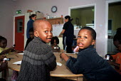 Children whose family are seeking asylum in Ireland at a playgroup at a Direct Provision Centre established by the Irish Government to house and care for refugees until their cases have been decided u... - Howard Davies - 2000s,2006,asylum,Asylum Seeker,Asylum Seekers,Asylum Seeker,Asylum Seekers,CARE,carer,carers,child,childcare,CHILDHOOD,CHILDMINDING,children,Diaspora,displaced,early years,edu education,education,eu,