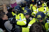 Students clash with riot police during protest against education cuts and university tuition fees , Brighton, UK 2010 - Howard Davies - 30-11-2010