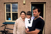A family who are seeking asylum in Ireland at a Direct Provision Centre established by the Irish Government to house and care for refugees until their cases have been decided upon. Co Meath, Ireland 2... - Howard Davies - 01-08-2004