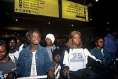 Refugee families from Liberia arriving in the UK as part of Gateway a UK government resettlement programme. The refugees had lived for more than a decade in camps in Guinea having fled the Liberian ci... - Howard Davies - 01-08-2004