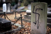 Hate crime. Jewish Graves desecrated with Nazi swastika by far right extremists, Aldershot Jewish cemetery - Howard Davies - 01-08-2004