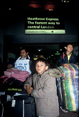 Refugee families from Burma arriving in the UK as part of Gateway a UK government resettlement programme. The refugees had lived in Thailand having fled oppression by the Burmese military. The familie... - Howard Davies - 2000s,2004,aid agency,air transport,airline,airport,AIRPORTS,ARRIVAL,arrivals,arrive,arrived,arrives,arriving,assistance,BAME,BAMEs,BME,bmes,britain,burma,burmese,child,CHILDHOOD,children,Diaspora,dis