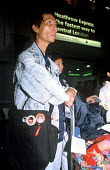 Refugee families from Burma with Aung San Suu Kyi badges arriving in the UK as part of Gateway a UK government resettlement programme. The refugees had lived in Thailand having fled oppression by the... - Howard Davies - 01-08-2005