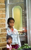 Refugee families from Burma at a reception house having arrived in the UK as part of Gateway a UK government resettlement programme. The refugees had lived in Thailand having fled oppression by the Bu... - Howard Davies - 2000s,2005,aid agency,assistance,BAME,BAMEs,Black,BME,bmes,britain,burma,burmese,child,CHILDHOOD,children,cities,city,Diaspora,displaced,diversity,ethnic,ethnicity,eu,europe,european,europeans,foreign