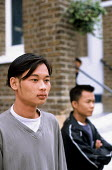 Refugee families from Burma at a reception house having arrived in the UK as part of Gateway a UK government resettlement programme. The refugees had lived in Thailand having fled oppression by the Bu... - Howard Davies - ,2000s,2005,aid agency,assistance,BAME,BAMEs,BME,bmes,britain,burma,burmese,cities,city,Diaspora,displaced,diversity,ethnic,ethnicity,eu,europe,european,europeans,foreign,foreigner,foreigners,governme