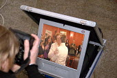 A TV monitor records the first kiss of Elaine Gaston and her partner of sixteen years Reverend Debbie Gaston during their ceremony as the first gay couple to ' marry ' when they signed the Civil Partn... - Howard Davies - 01-08-2005