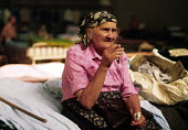 Elderly Bosnian Muslim refugee in a makeshift camp in a sports hall near Zagreb. Croatia. 1992 - Howard Davies - 1990s,1992,age,ageing population,balkan,balkans,BAME,BAMEs,BME,bmes,bosnia,bosnian,bosnians,camp,camps,conflict,conflicts,croatia,croatian,Diaspora,displaced,diversity,elderly,EQUALITY,ethnic,Ethnic C