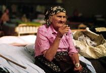 Elderly Bosnian Muslim refugee in a makeshift camp in a sports hall near Zagreb. Croatia. 1992 - Howard Davies - 01-08-1992
