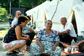 Bosnian Muslim refugees living in tents in a refugee camp. Djakovo, Croatia. 1992 - Howard Davies - 01-08-1992